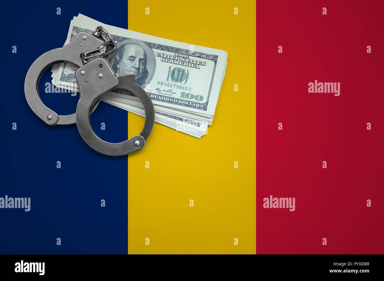 Chad flag  with handcuffs and a bundle of dollars. The concept of breaking the law and thieves crimes. - Stock Image