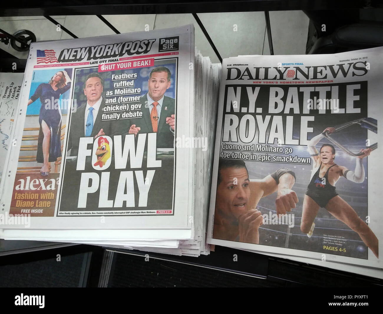 Headlines of the New York Post and New York Daily News on Wednesday, October 24, 2018 report on the previous day's debate between incumbent Democratic Gov. Andrew Cuomo and his Republican opponent Marc Molinaro.  (© Richard B. Levine) - Stock Image