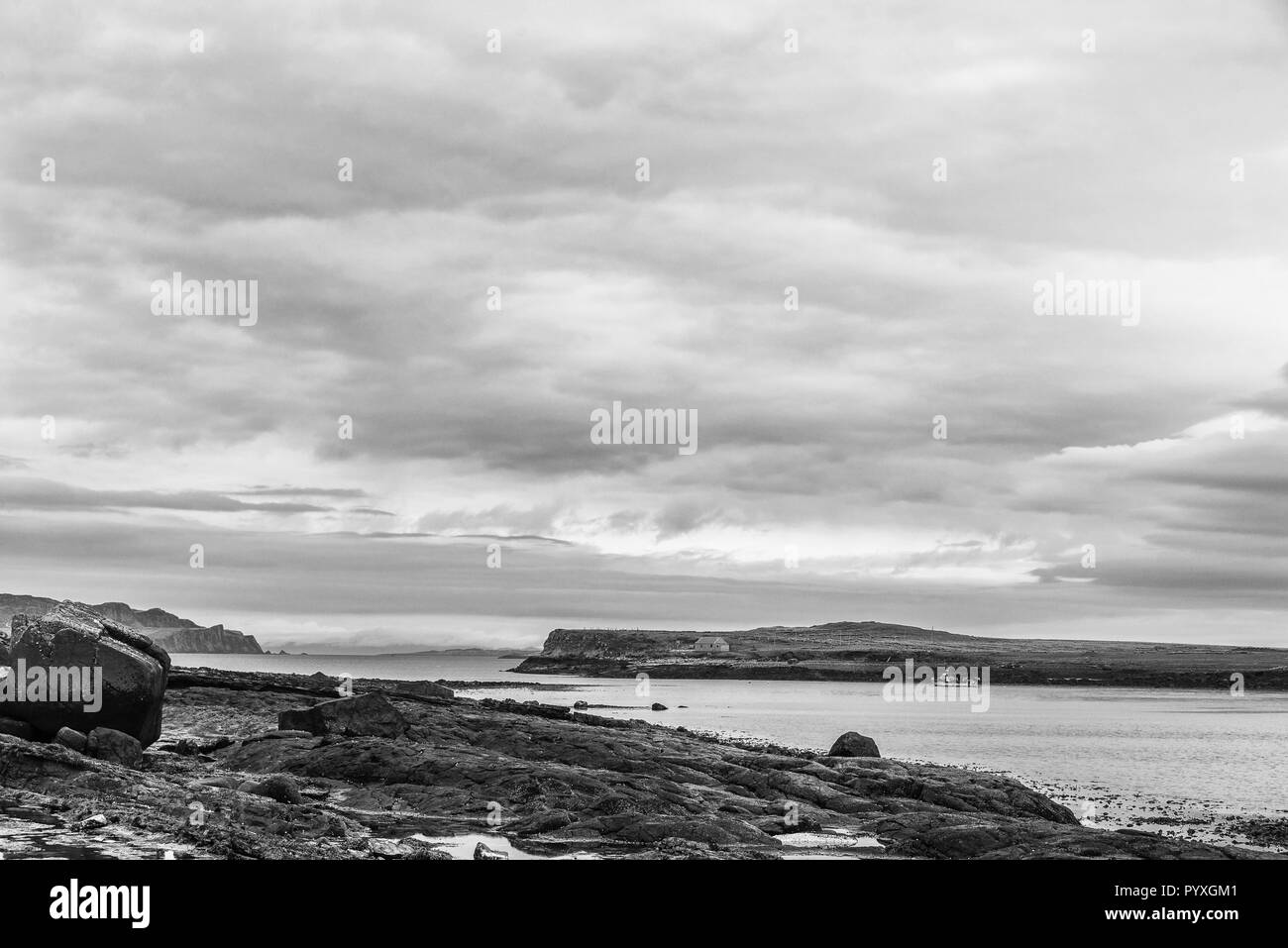 a cloudy morning sunrise over Staffin coastal road, isle of skye - Stock Image