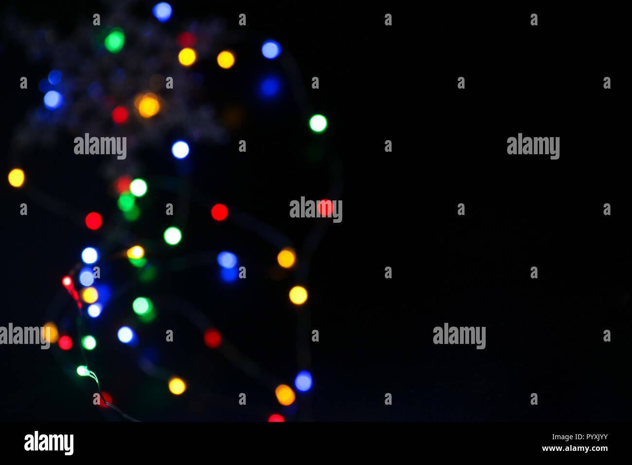Many blurred bright bubble lights bokeh colorful drops  New year and