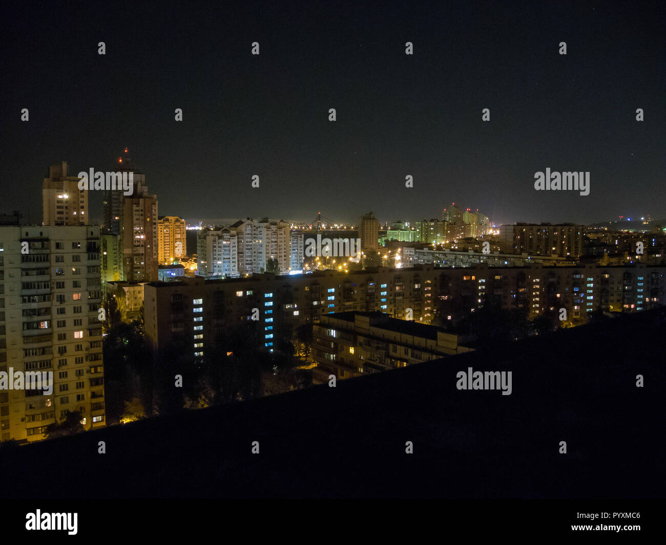 Night city landscape, sleeping quarters with tall houses - Stock Image