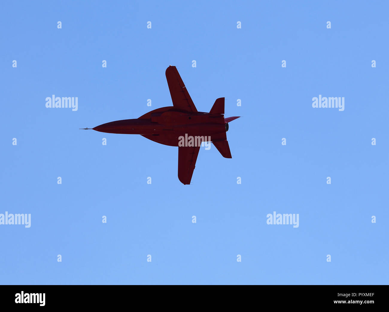 Single jet aircraft with a swept wing, bottom view - Stock Image