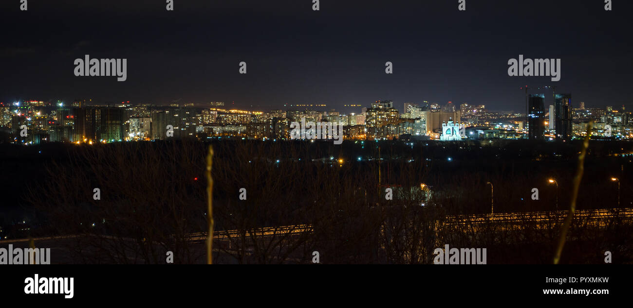 Panorama of night city landscape, sleeping quarters with tall houses and crossroads - Stock Image