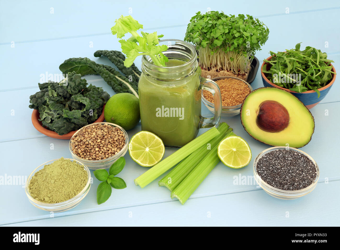 Health Food Vegetable Smoothie Juice Drink With Wheat Grass Powder Chia Flax And Hemp Seed On Blue Wood Background Stock Photo Alamy