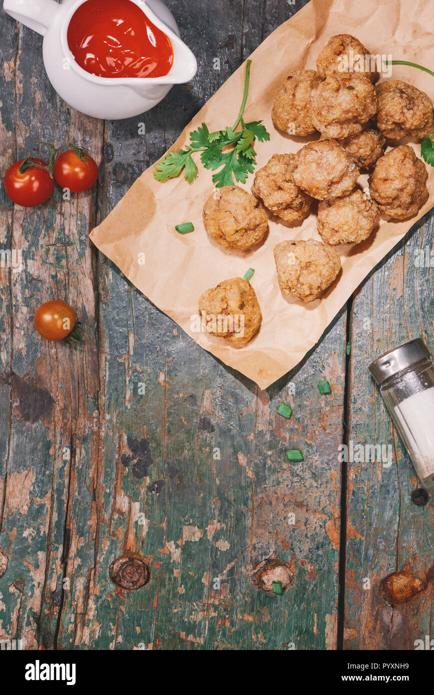 Vietnamese food. Delicious homemade fish balls on wooden table. - Stock Image