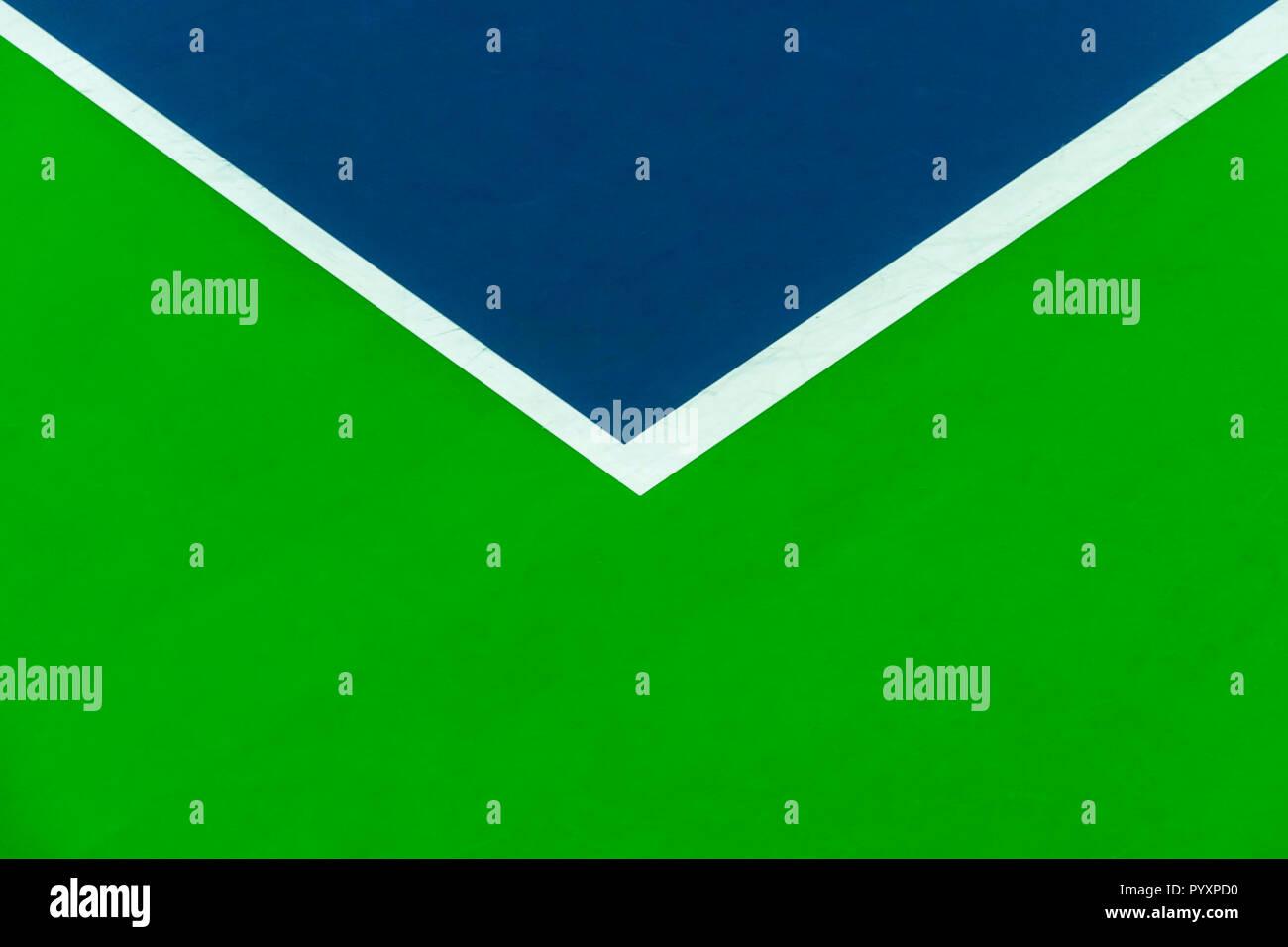 Corner white baseline on floor of tennis court - Stock Image