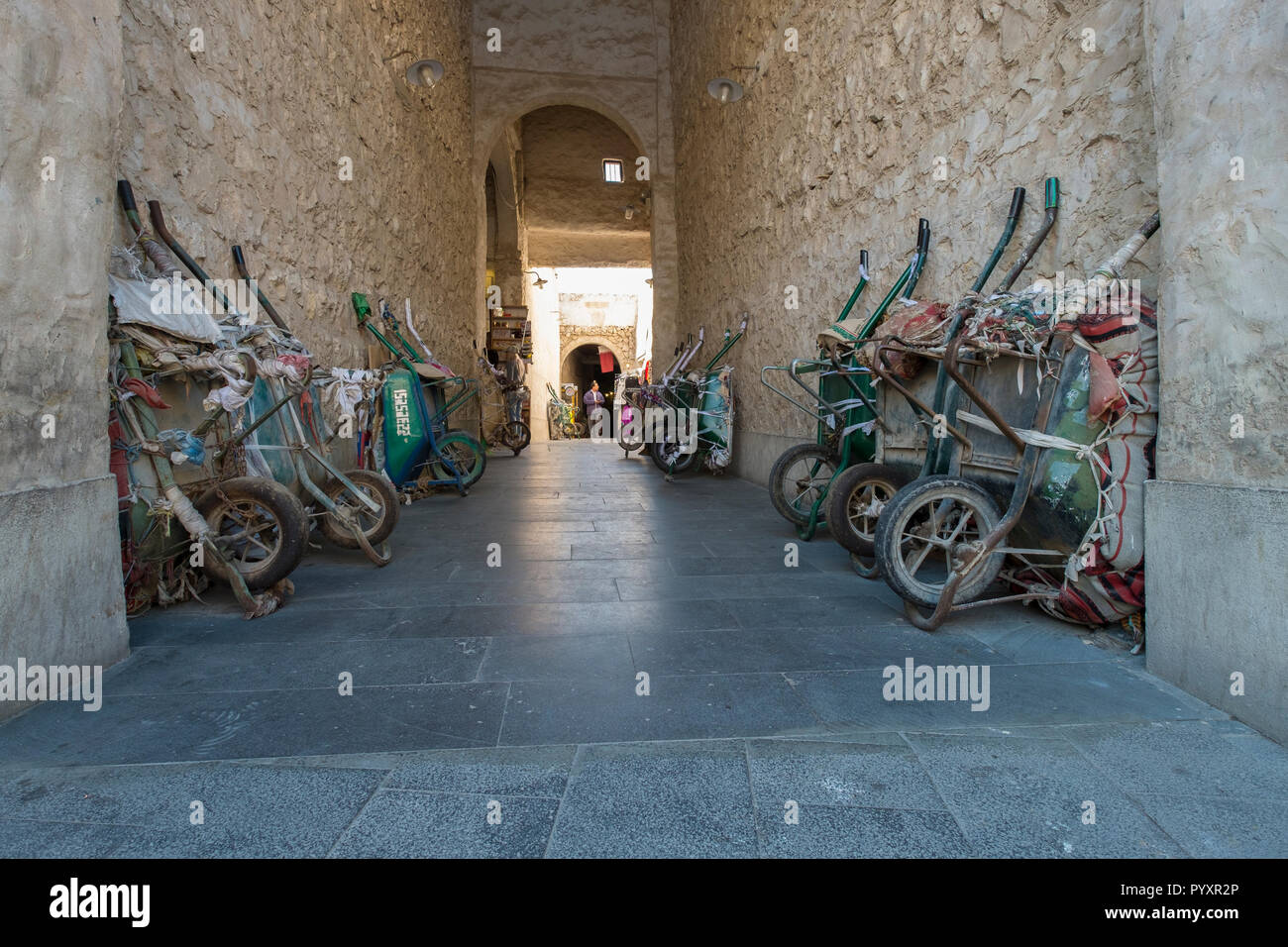 Wheelbarrows lined up in the Souk in Doha, Qatar - Stock Image