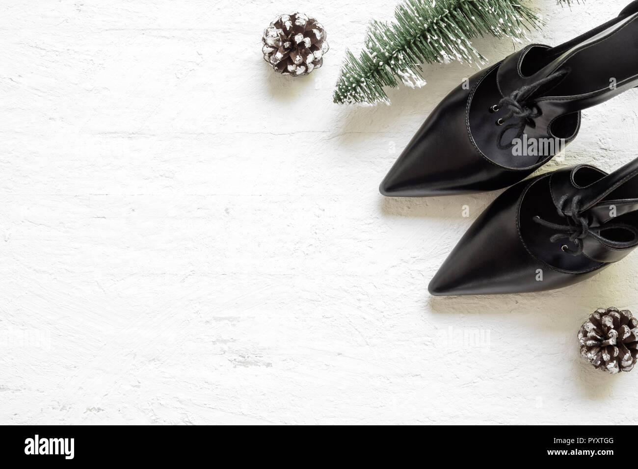 Flat Lay Black High Heel Shoes And Mini Christmas Tree And Pine Cones On Grunge White Wood Background Merry Christmas And Winter Season Fashion Backg Stock Photo Alamy