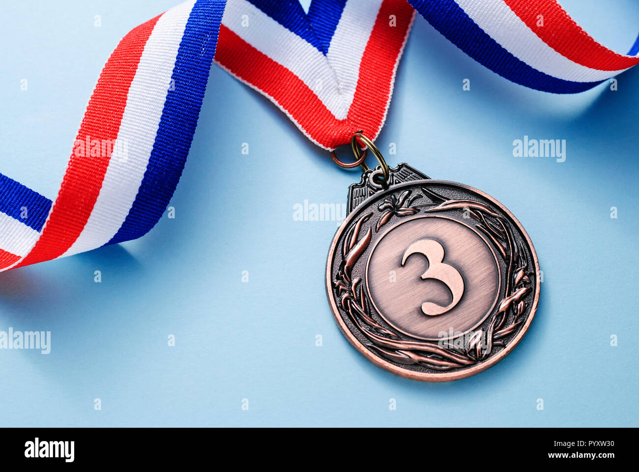 Bronze medal 3 place with a ribbon - Stock Image