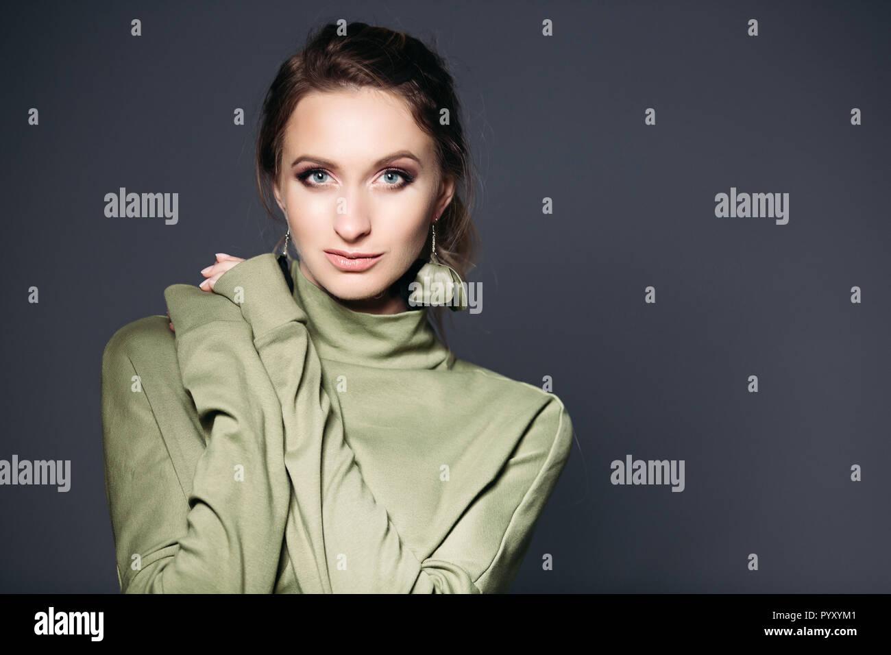 Beauty portrait of brunette woman with wearing in khaki dress. - Stock Image