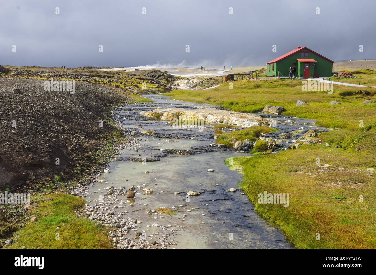 Hot steam coming from the boiling water in the central Iceland in the geothermal area of Hveravellir. - Stock Image