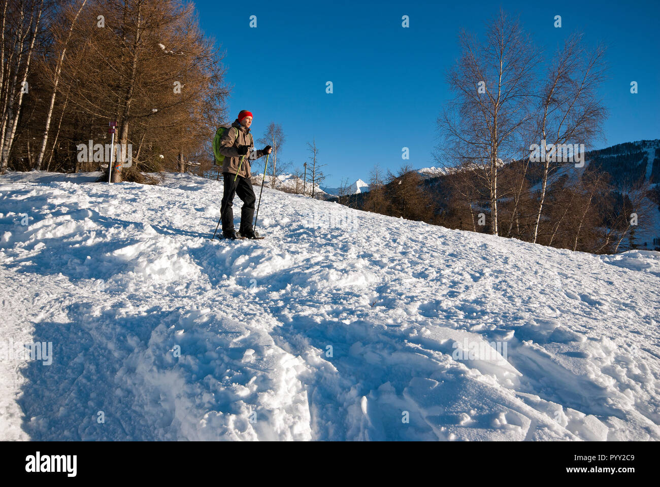 Winter trekking with snowshoes in Orobie Alps, Lombardy, Italy - Stock Image