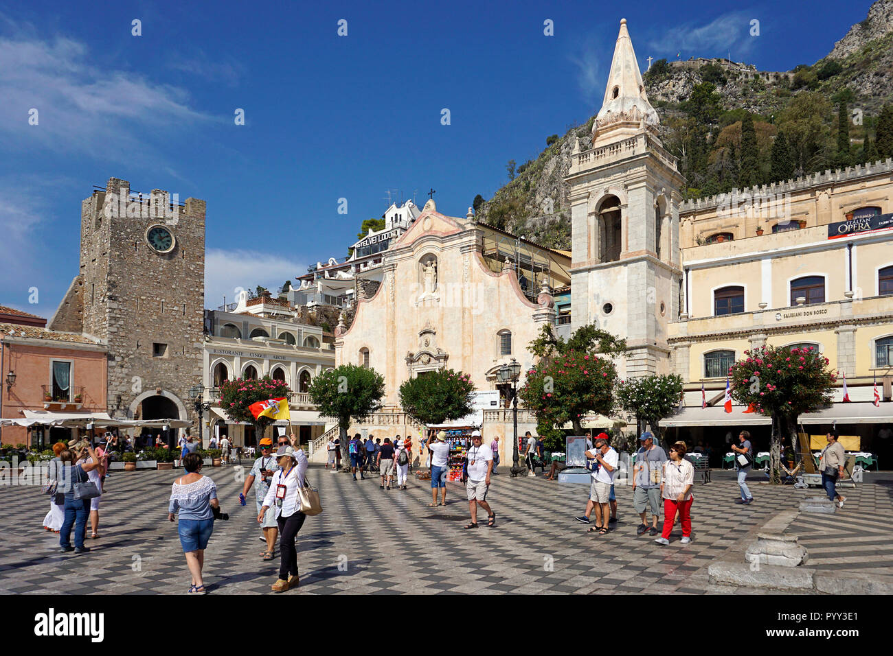 The church of San Giuseppe and the clock tower Torre dell'Orolorgio in Piazza IX. Aprile, old town of Taormina, Sicily, Italy - Stock Image
