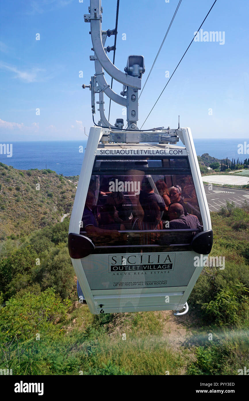 Cable car ride from the old town Taormina to the district Mazzarò by the sea, Sicily, Italy - Stock Image
