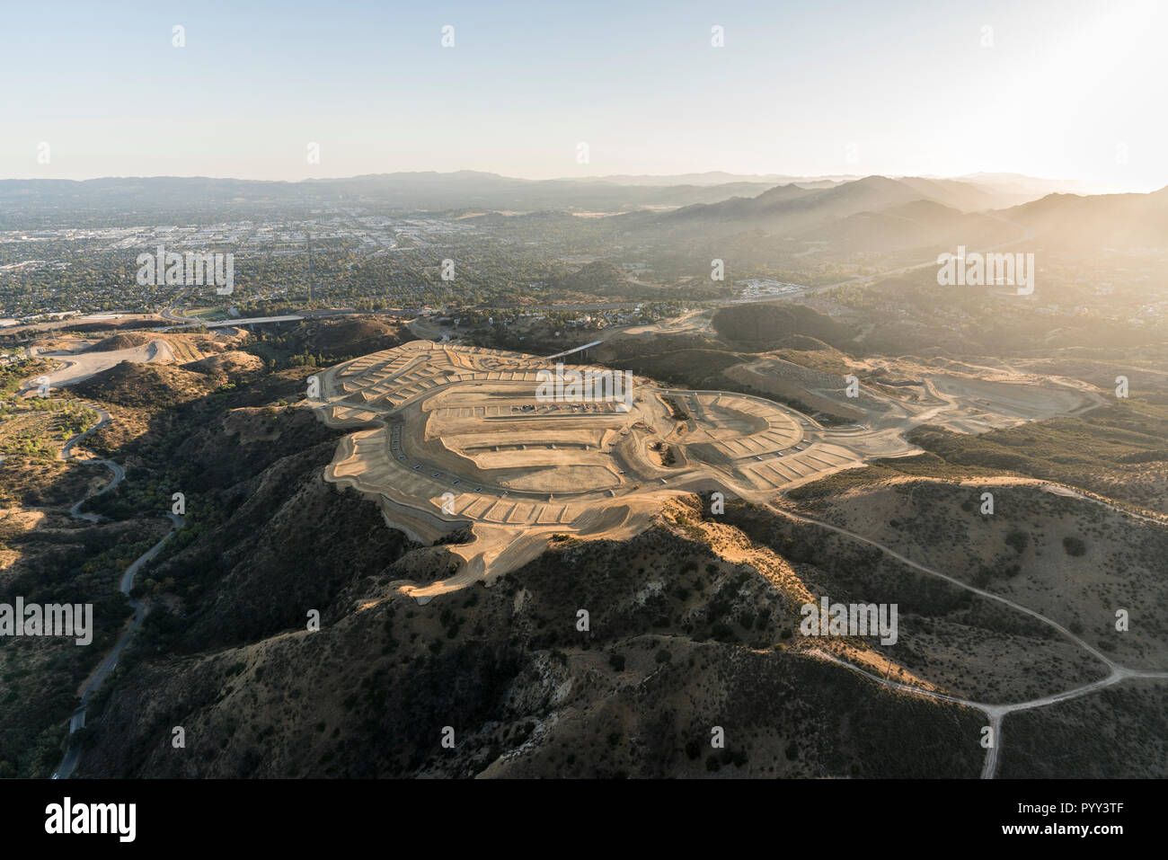 Aerial view of hilltop construction grading near the Porter Ranch community in the San Fernando Valley area of Los Angeles, California. - Stock Image