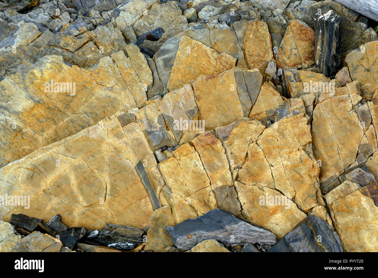Jagged rock detail with geometric patterns - Stock Image