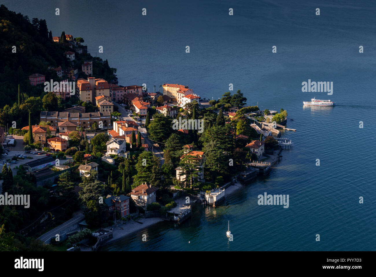 Ferry approaching the harbour at Varenna on Lake Como, Italy Stock Photo