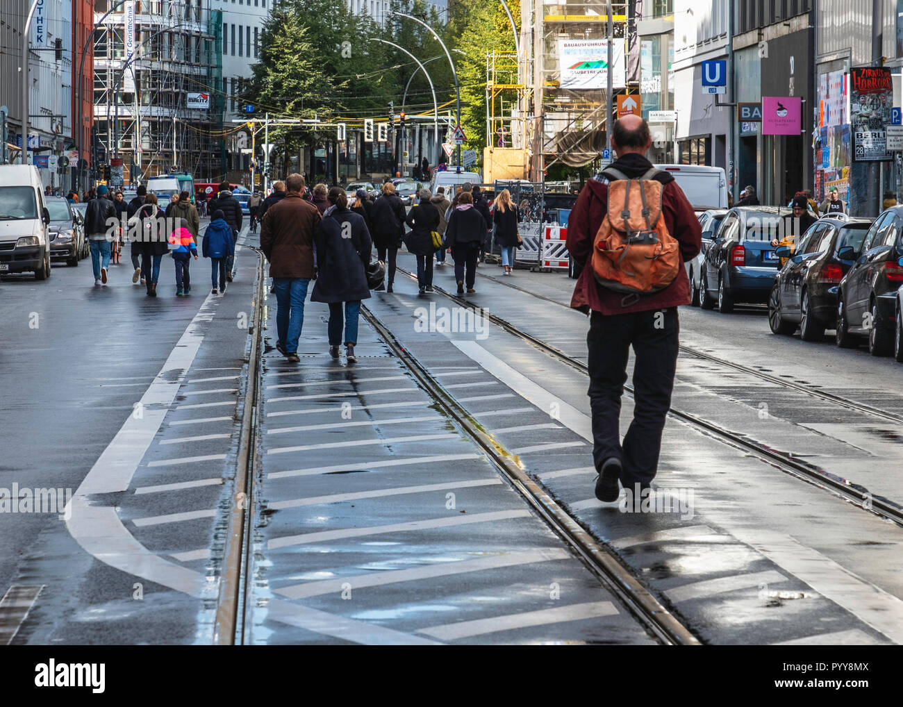 Berlin, Mitte, Brunnenstarsse. People walk in centre of traffic-free street wuich is closed to cars - Stock Image