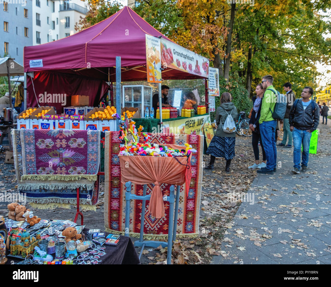 Germany,Berlin,Bernauerstrasse. Fleamarket stalls across the road from the main Mauerpark market sell collectibles, books, clothing , - Stock Image