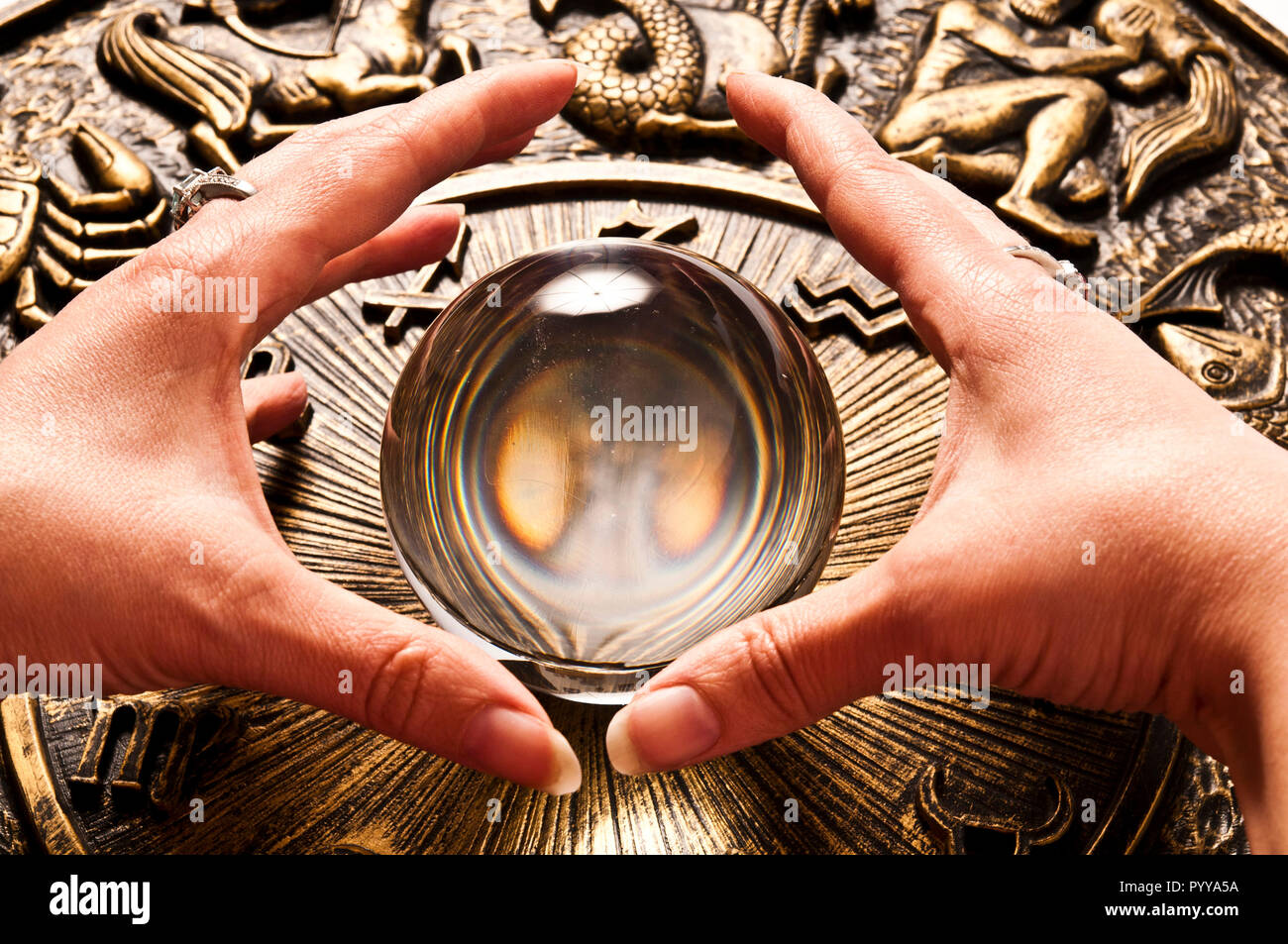 fortune teller hands and magic sphere for divination - Stock Image