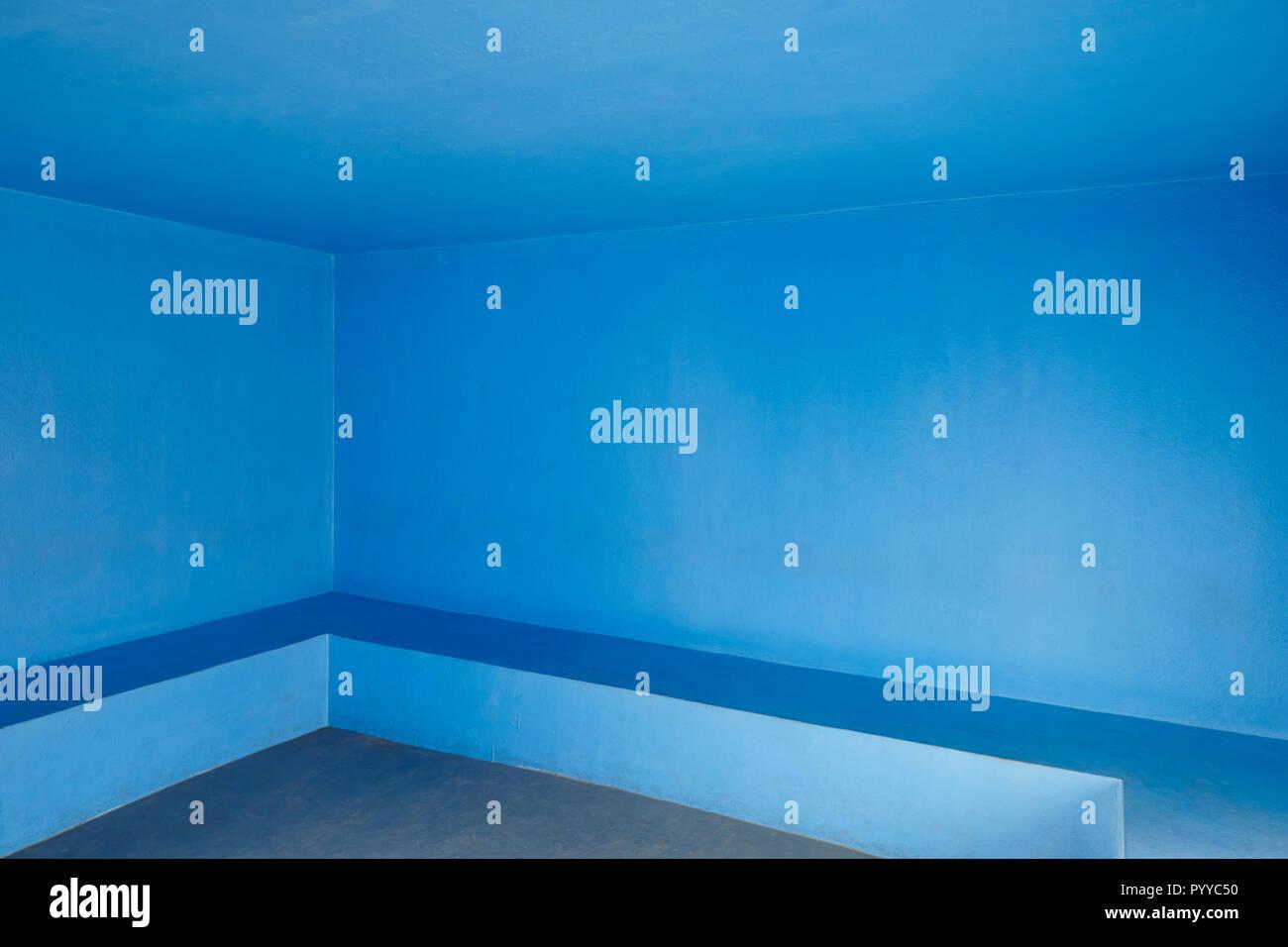 Blue concrete walls indoor room. Minimalist interior architecture. Horizontal Stock Photo