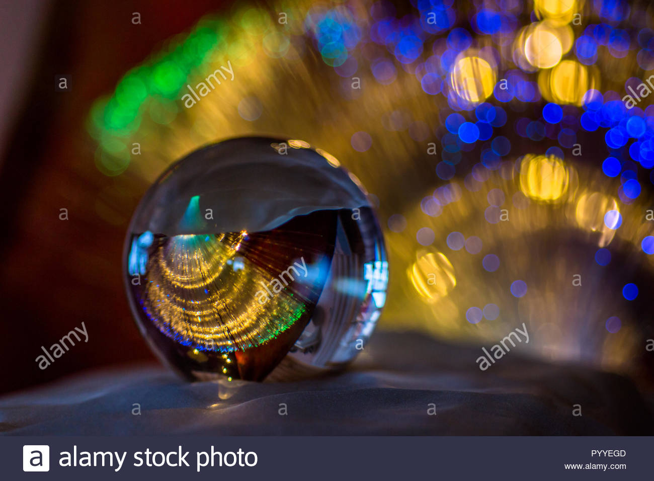 glas bowl with a colorful background - Stock Image