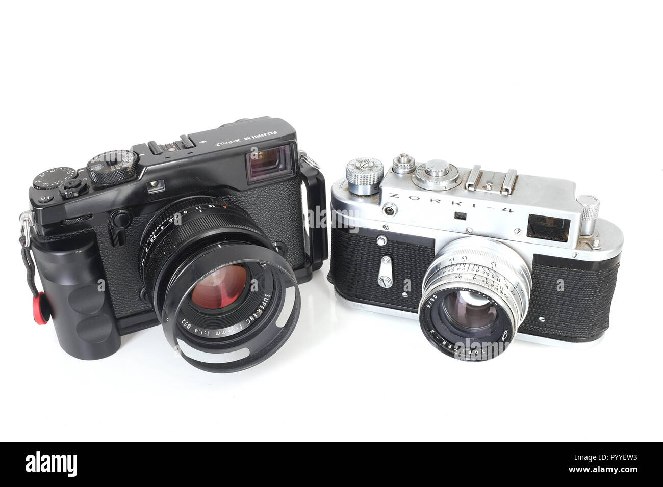 October 2018 - Old and new, A Russian Zorki 35mm range finder camera together with a modern Fujifilm X-Pro2 camera. - Stock Image
