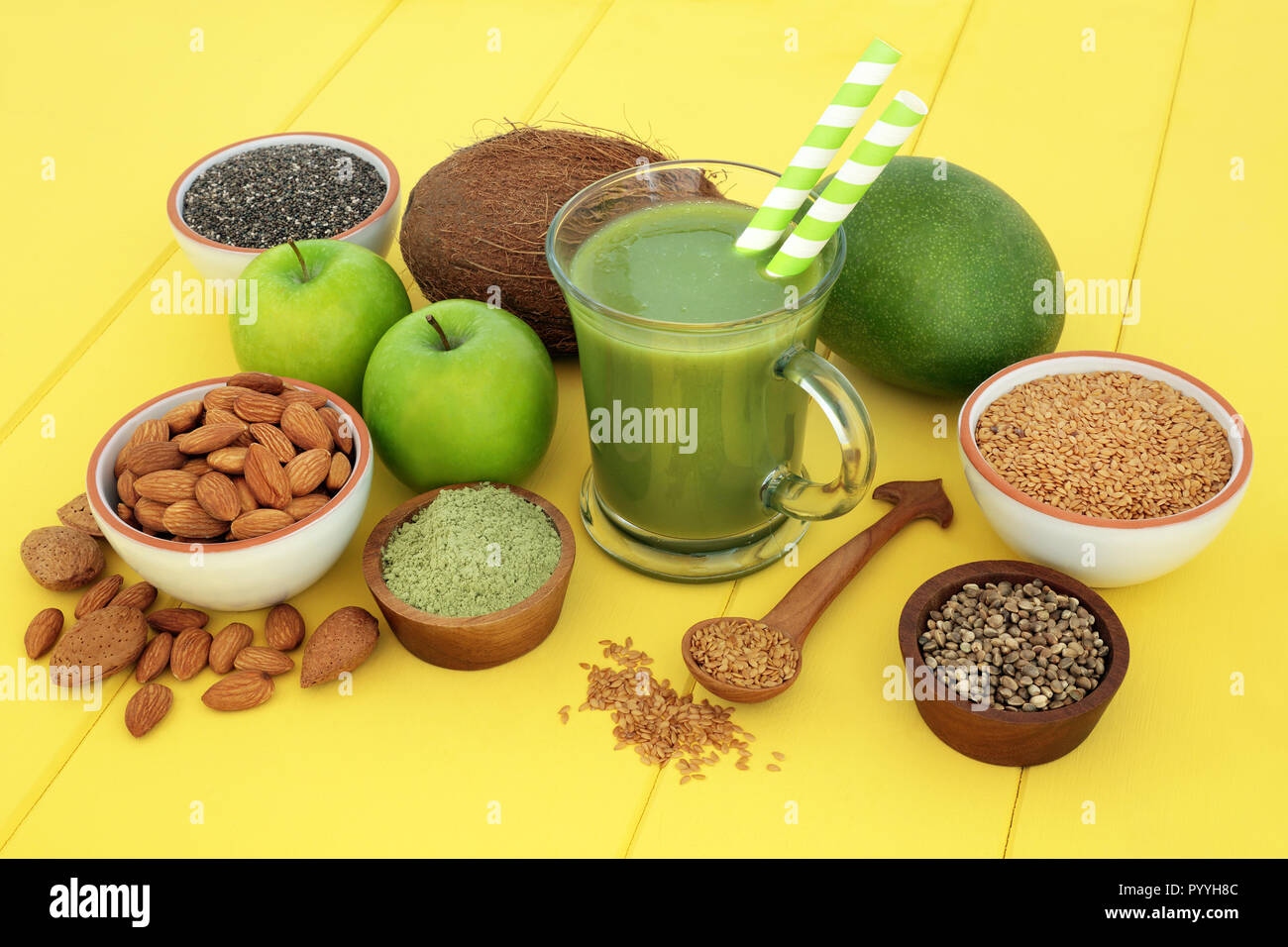 Fresh Fruit Juice Health Drink With Matcha Flax Chia And Hemp Seed Nuts And Fruits On Yellow Wood Background Stock Photo Alamy