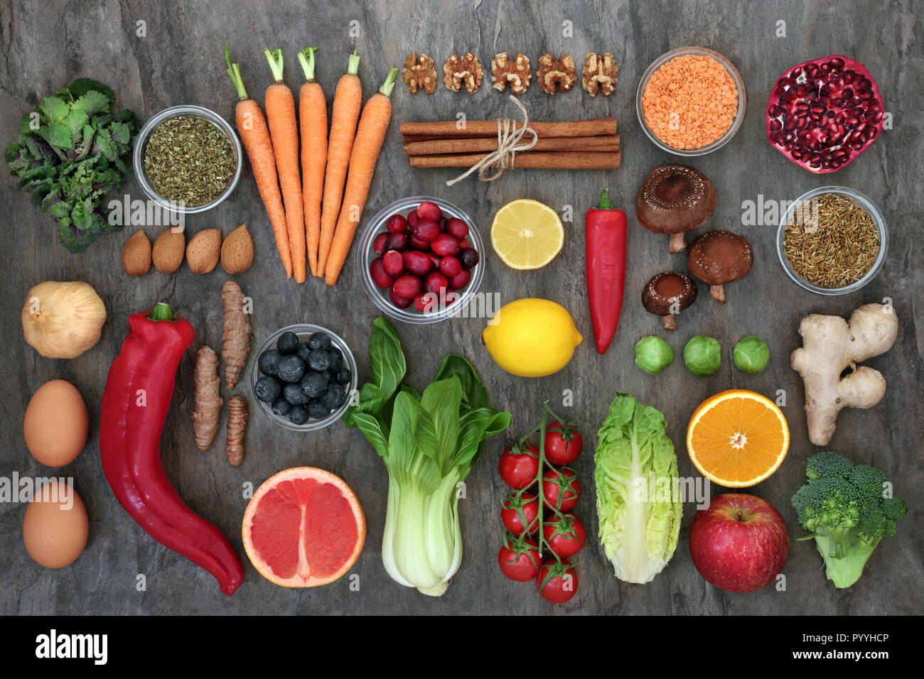 Health food to slow ageing process concept including fruit, vegetables, spices and herbs used in herbal medicine . - Stock Image