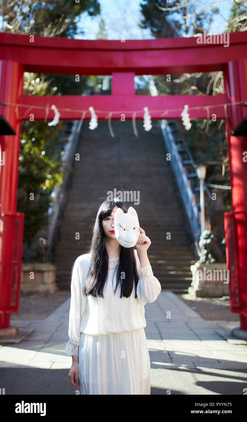 Young Japanese woman with fox mask Stock Photo: 223729497