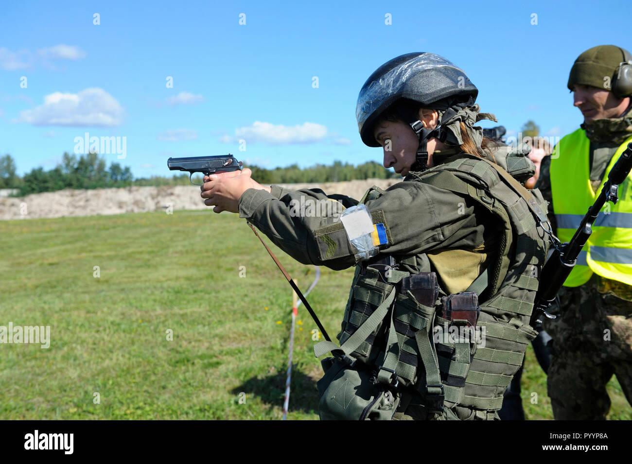 On a military shooting range, training: Ukrainian soldier machine gun firing. October 18, 2018. Novo-Petrivtsi military base, Ukraine - Stock Image