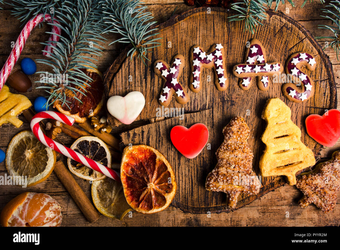 New Year and Christmas treats and sweets. Waffles and cookies with decorations top view - Stock Image