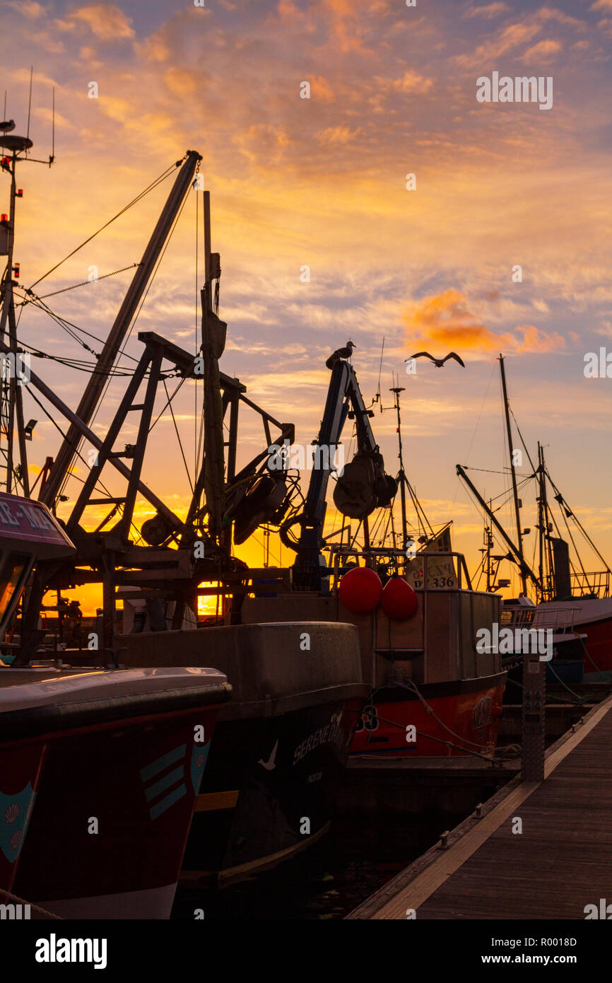 Newlyn, Cornwall, UK, 31st October 2018. Stunning red skies over the fishing port of Newlyn this morning. Credit: Mike Newman/Alamy Live News. Stock Photo