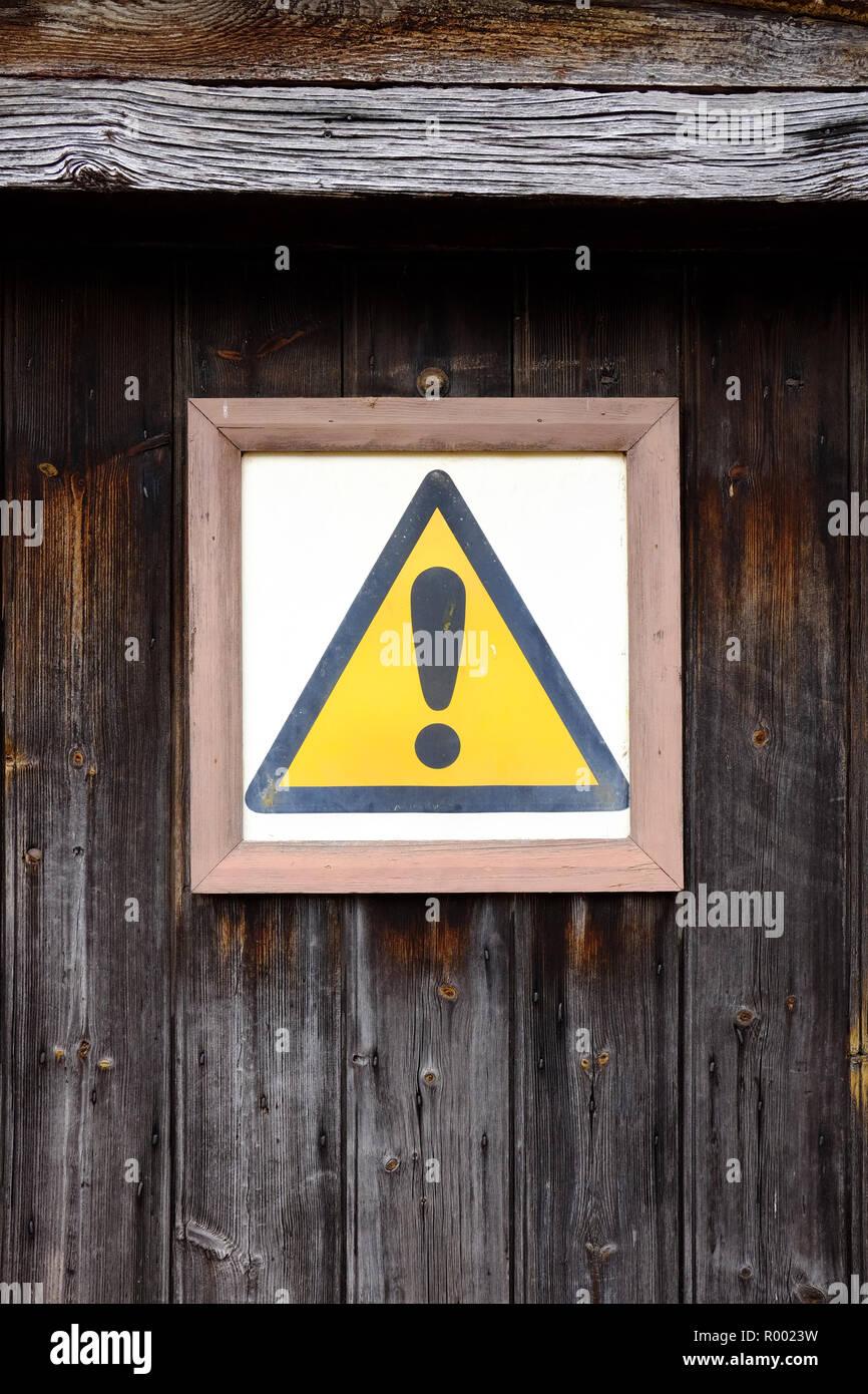 Hazard sign on a door - Stock Image
