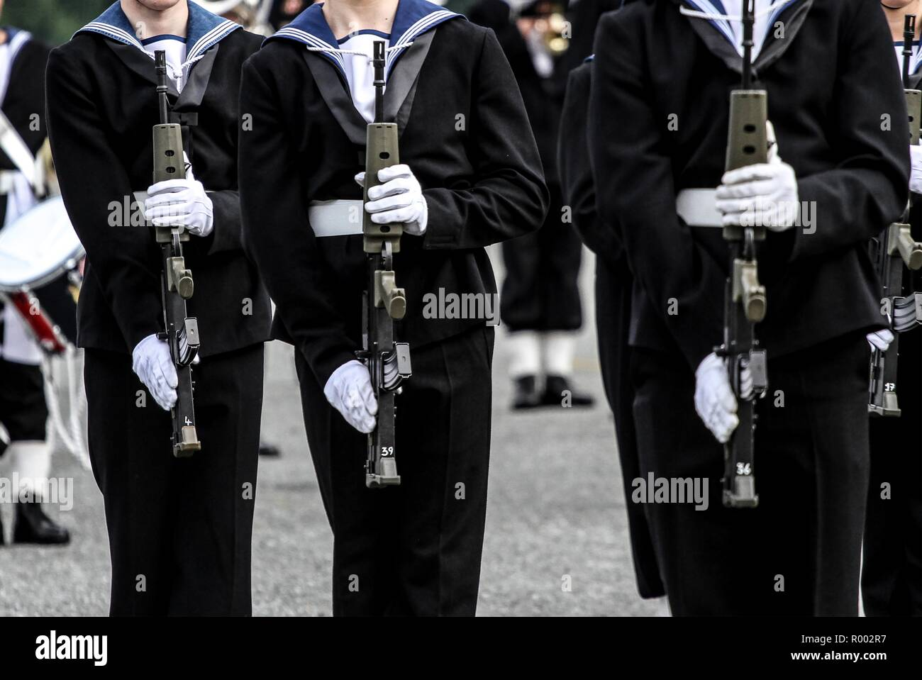 Royal Navy Display Guard with rifles on parade with prince andrew - Stock Image