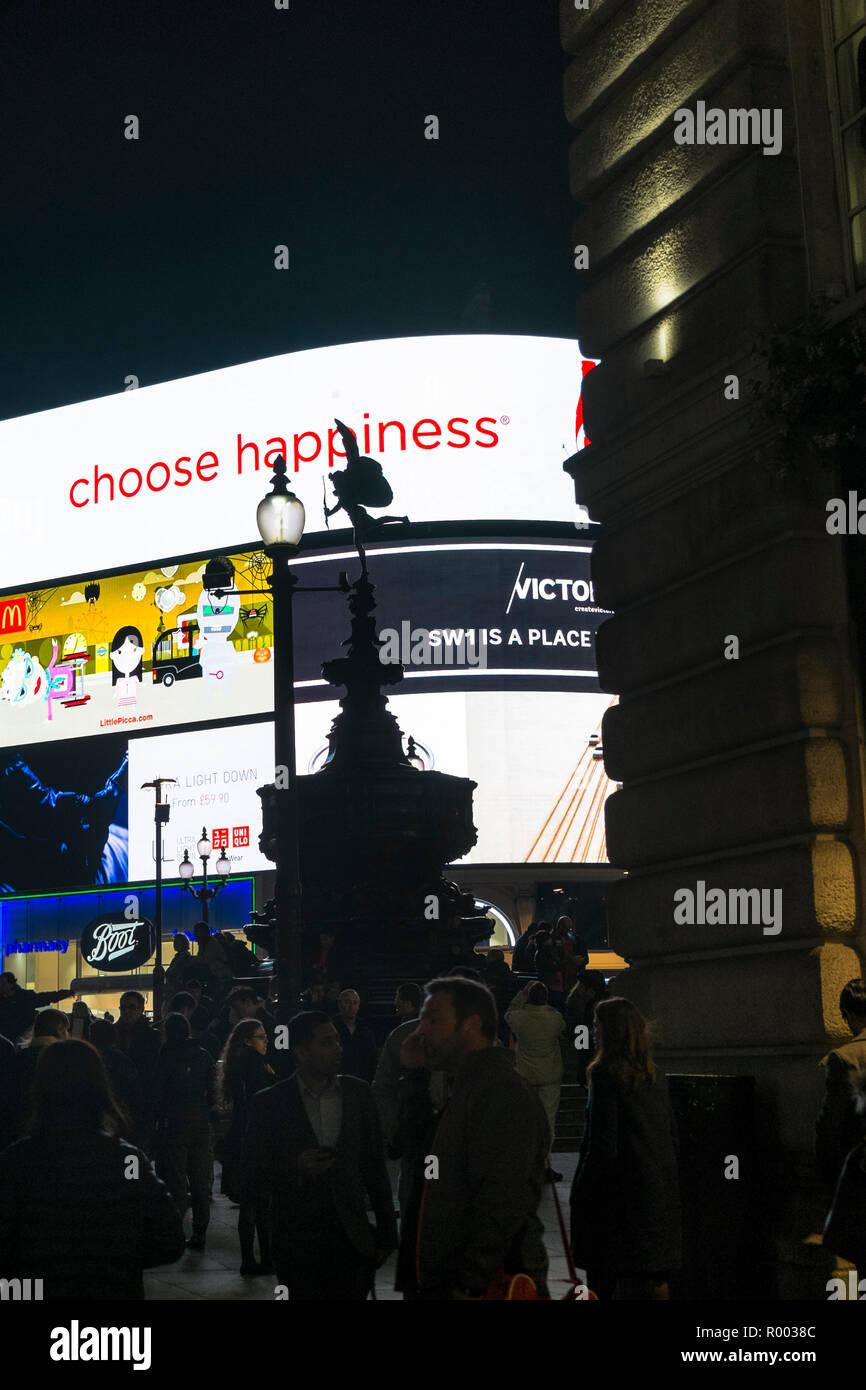 choose happiness, neon sign at trafalgar square - Stock Image