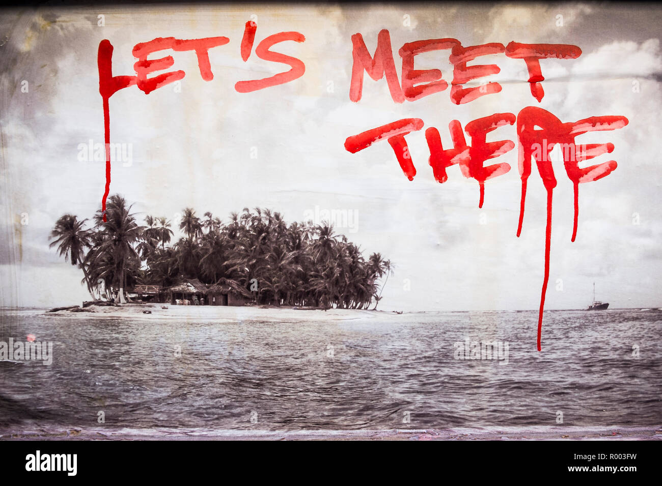 black and white photograph of a tropical island and the inscript 'let´s meet there' - Stock Image