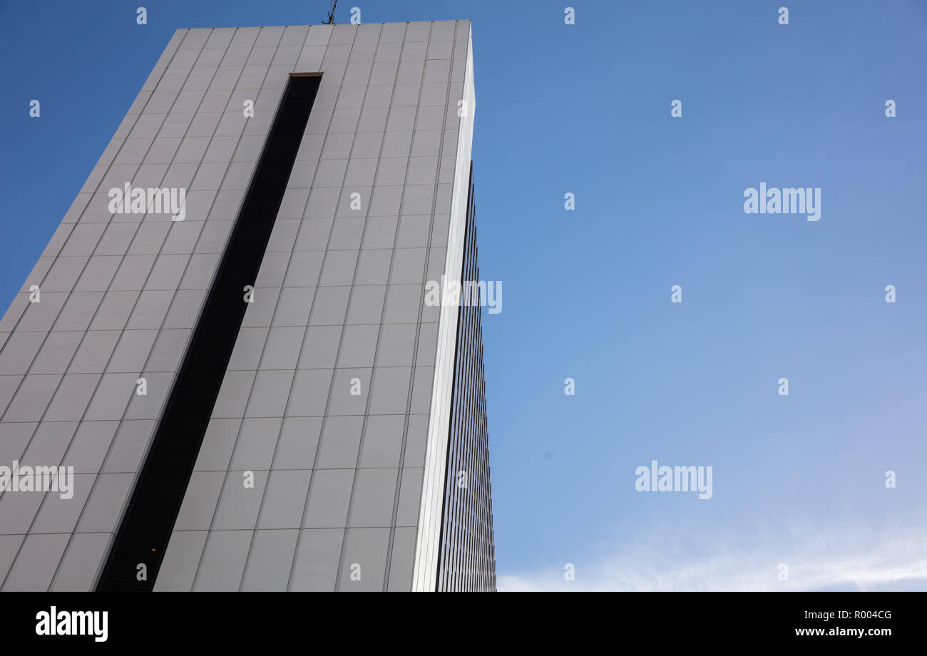 Low angle skyscraper multi story office building in Berlin, Germany, against blue sky background, copy space. - Stock Image