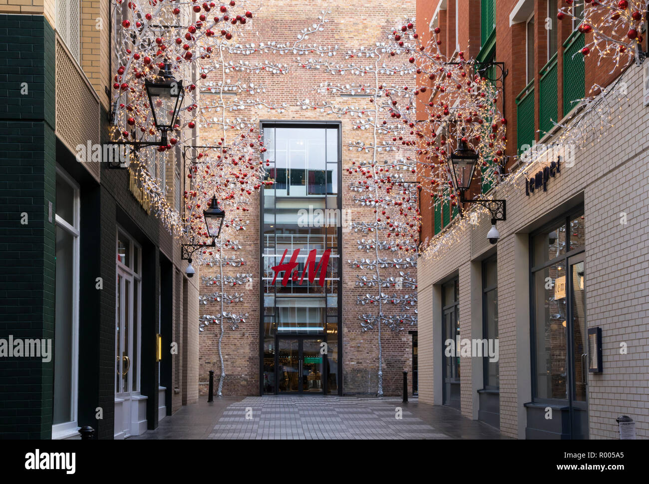 H&M, Mercer Walk, Seven Dials, Covent Garden, London, Christmas decorations and lights Stock Photo