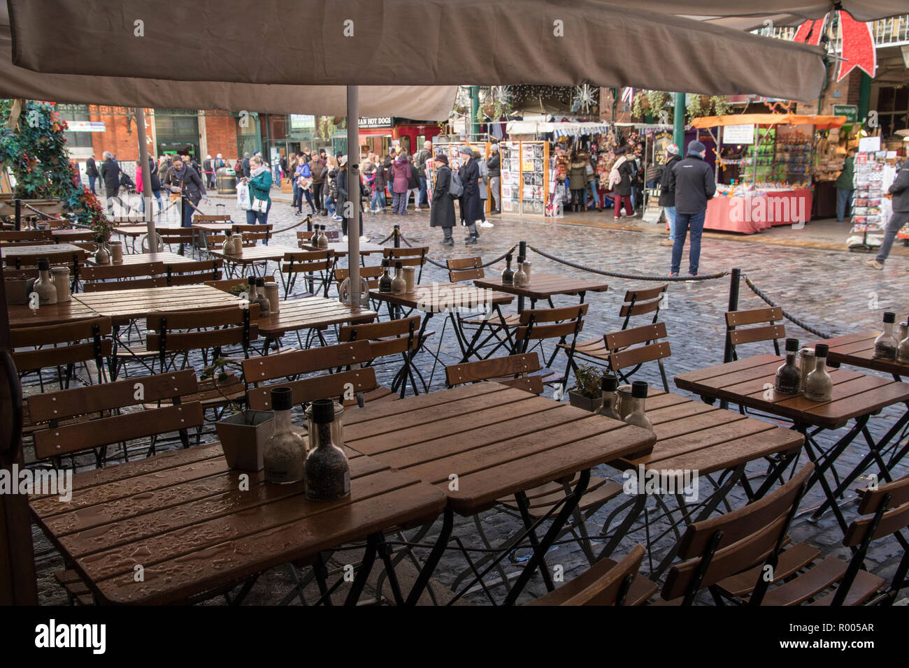Wet Sunday morning, Covent Garden Market, London. Outdoor restaurant tables after rain. Stock Photo
