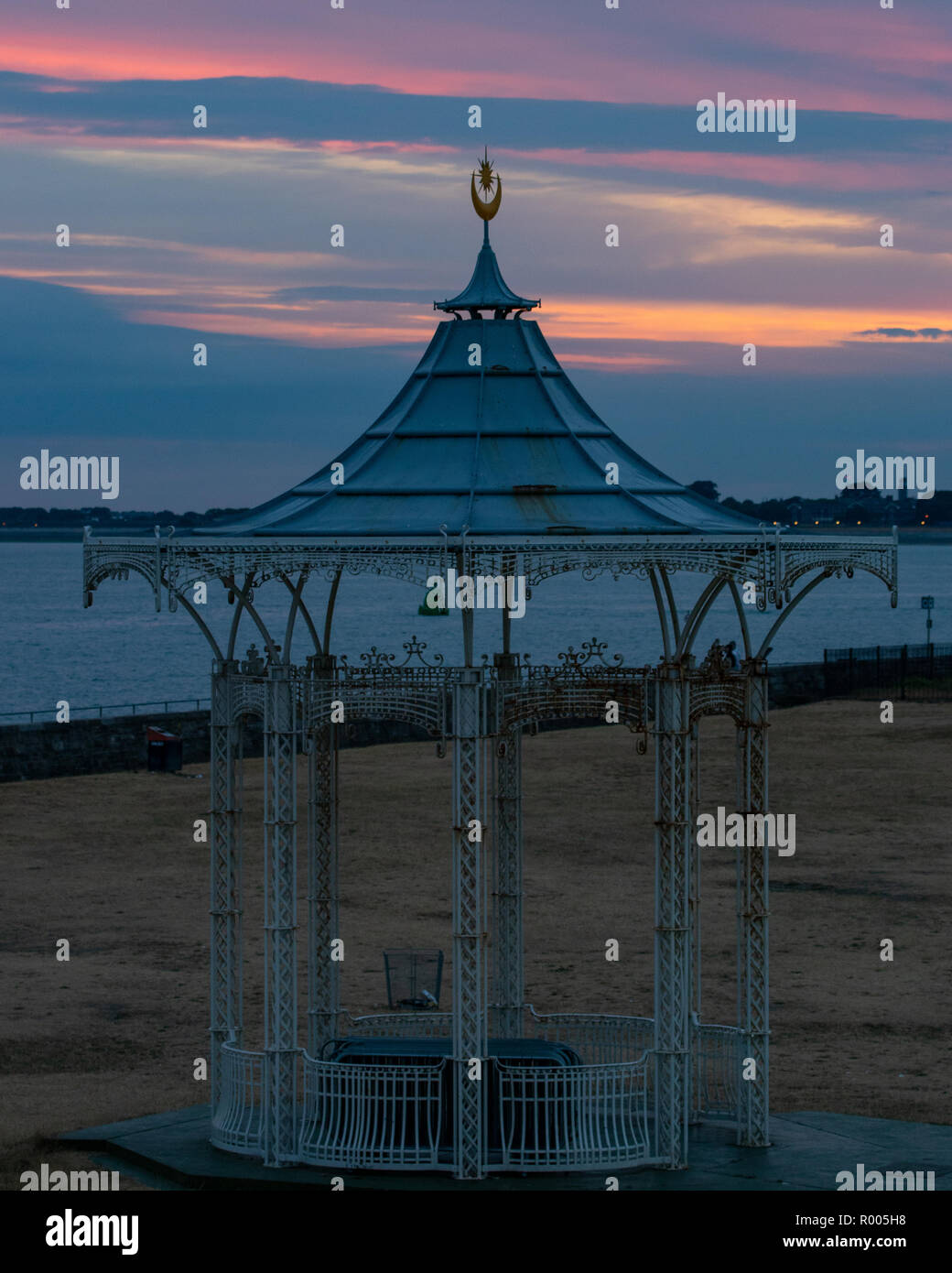 Southsea victorian bandstand roof with star and half moon crest at sunset in Southsea - Stock Image