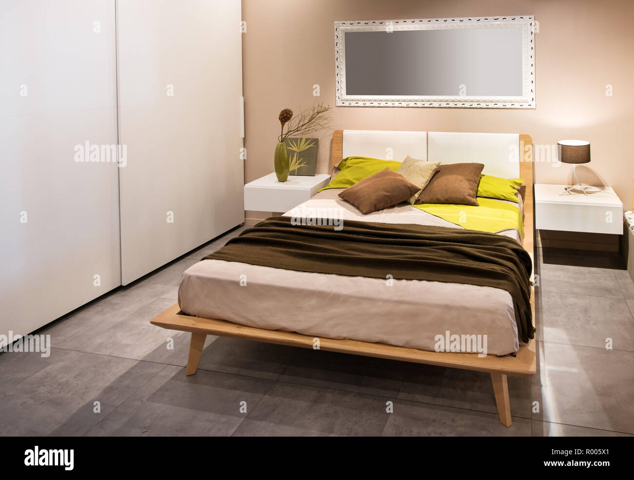 Modern bedroom with wooden scandinavian style bed and side