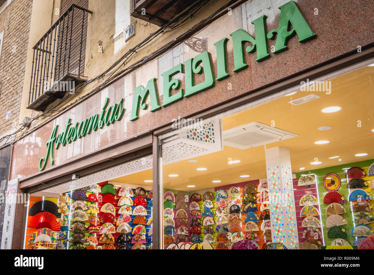 Toledo, Spain - April 28, 2018 - front of a multicolor fan shop in the historic center, symbol of Spanish culture Stock Photo