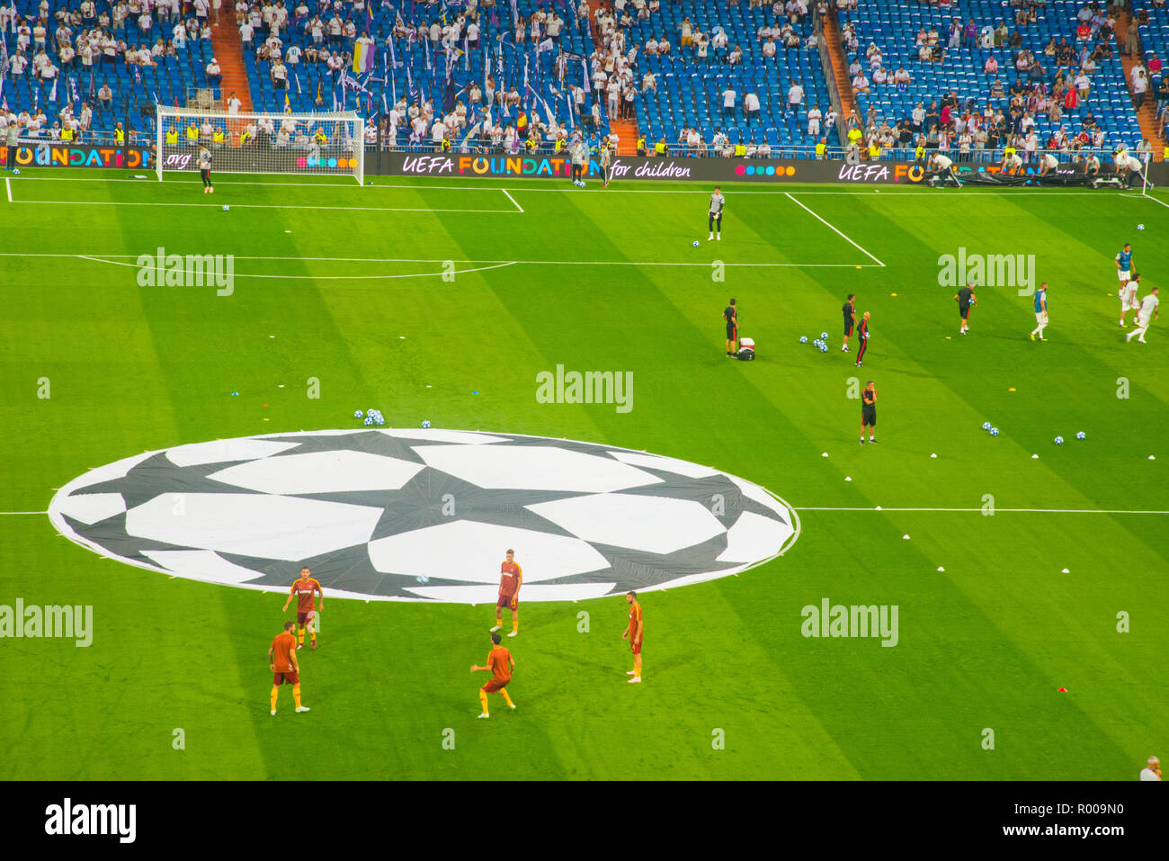 Warm-up exercises before football match. Champions League, Santiago Bernabeu stadium, Madrid, Spain. - Stock Image