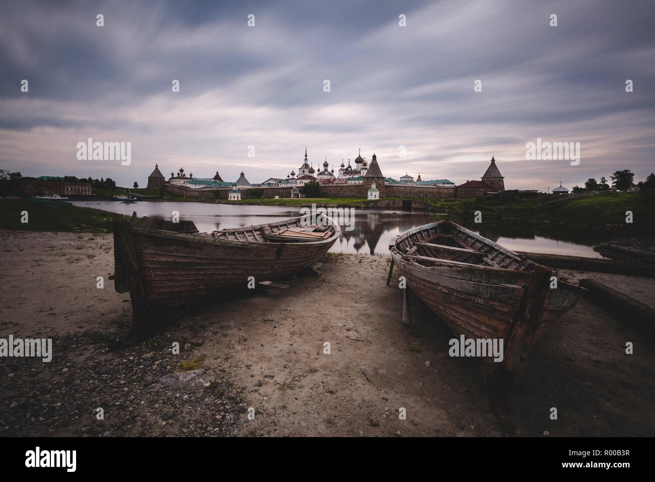 Two old wooden boats on the background of the Solovetsky Monastery, Russia Stock Photo