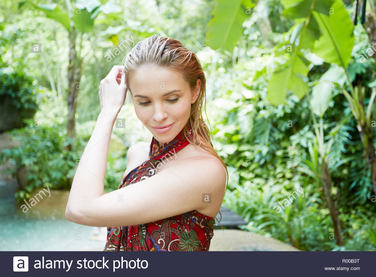 Young woman with wet hair by tropical trees Stock Photo