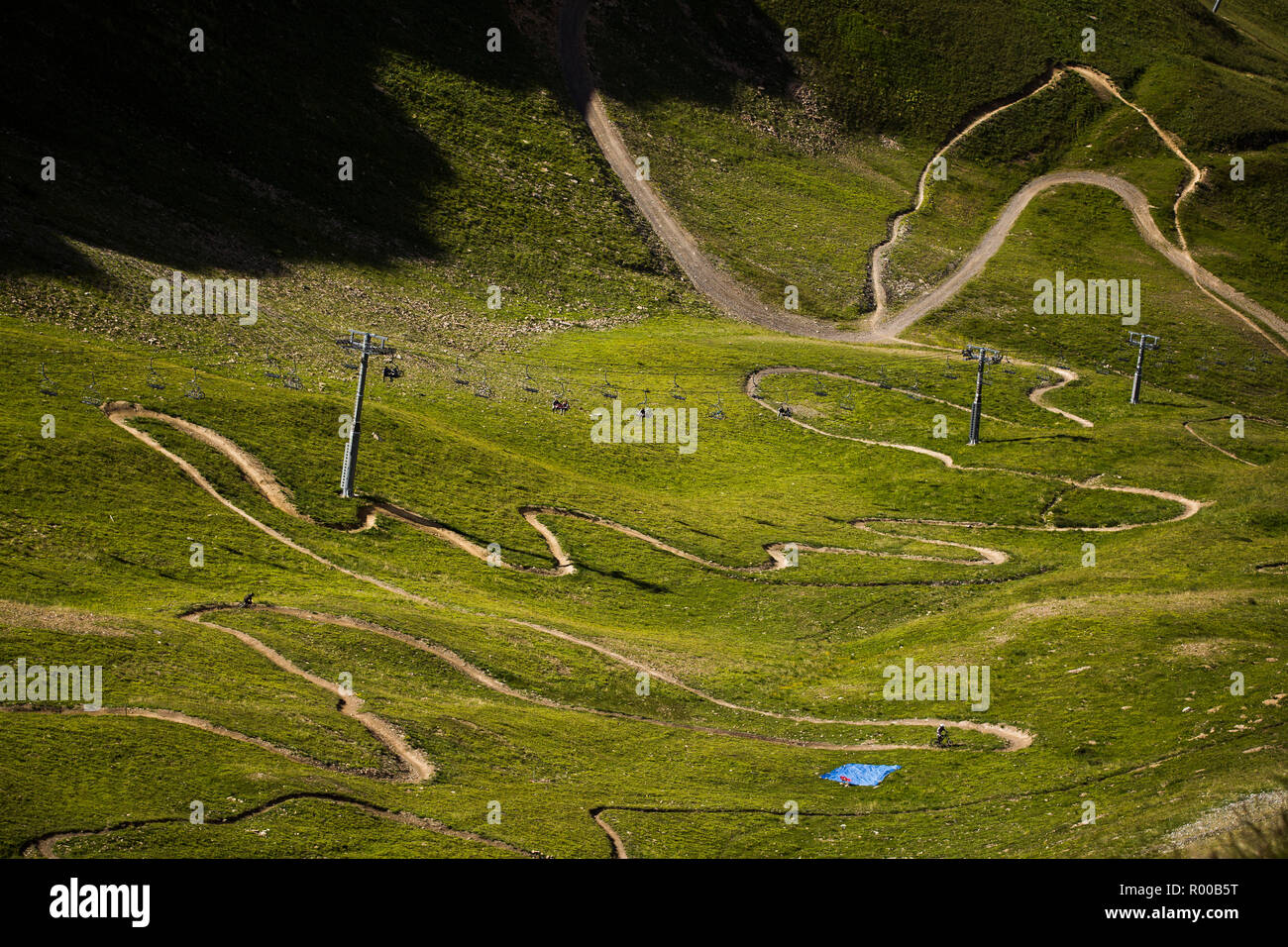 Mountain Bikers on a singletrack with many hairpin bends - Stock Image