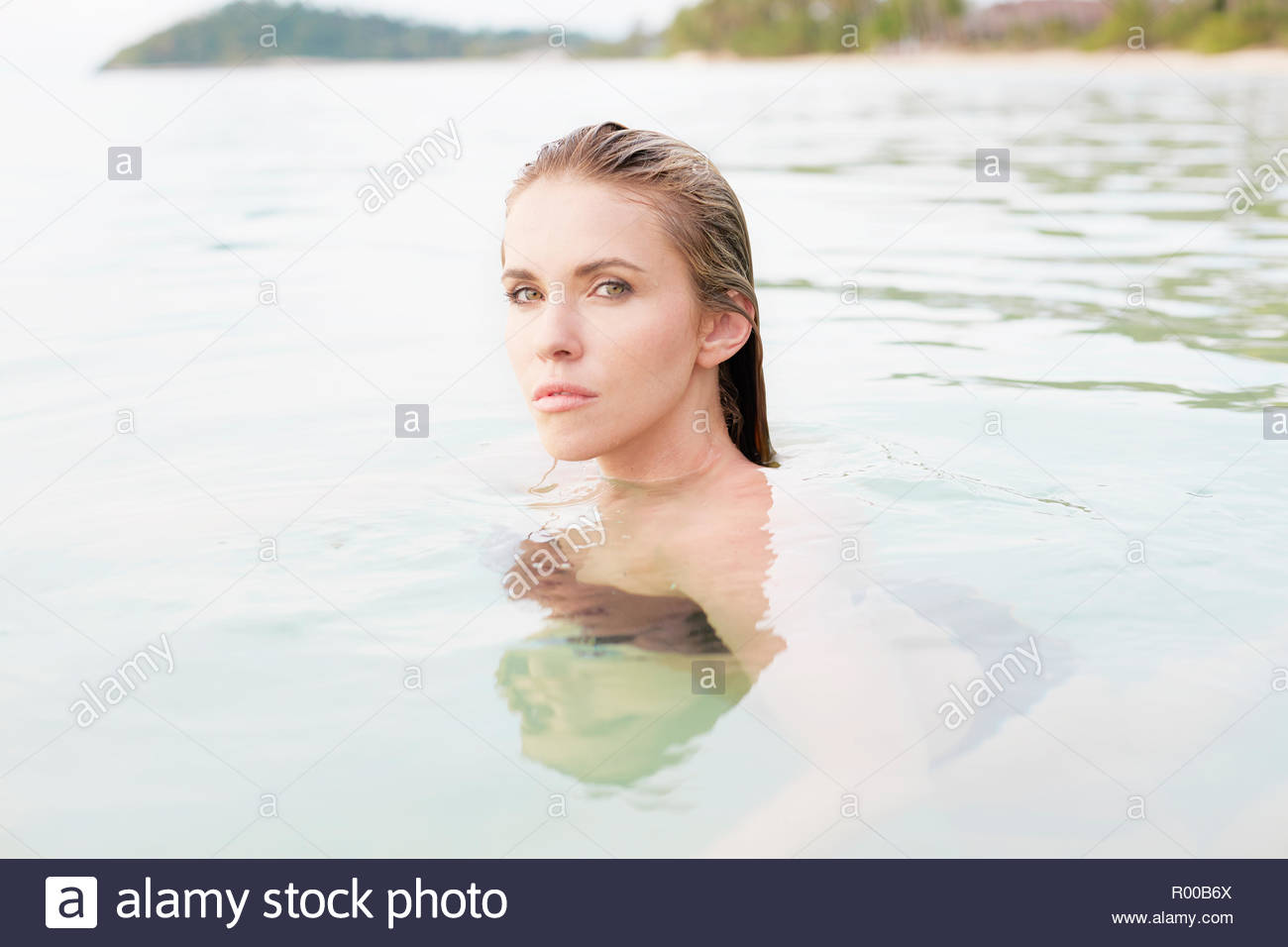 Young woman with wet hair in sea Stock Photo