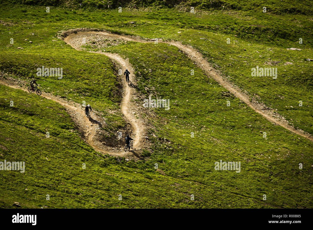 Mountain Bikers on a singletrack with berms - Stock Image