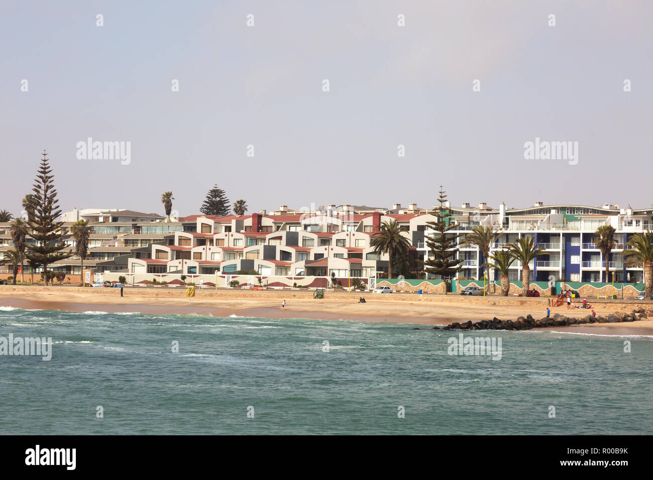 Swakopmund houses - houses and buildings on the beach at the resort town of Swakopmund, Namibia Africa - Stock Image